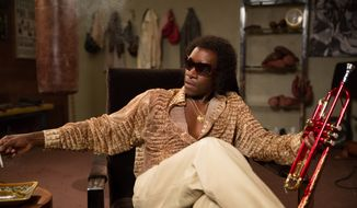 "This image released by Sony Pictures Classics shows Don Cheadle as Miles Davis in a scene from, ""Miles Ahead."" (Brian Douglas/Sony Pictures Classics via AP)"