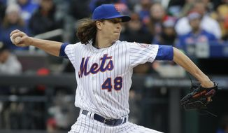 New York Mets pitcher Jacob deGrom (48) delivers against the Philadelphia Phillies during the first inning of a baseball game, Friday, April 8, 2016, in New York. (AP Photo/Julie Jacobson)