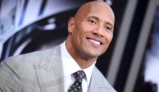 """FILE - In this May 26, 2015 file photo, Dwayne Johnson arrives at the premiere of """"San Andreas"""" at the TCL Chinese Theatre in Los Angeles. Will Smith, Charlize Theron, Melissa McCarthy and Chris Hemsworth are set to bring their star power to the MTV Movie Awards this weekend. Kevin Hart and Johnson will host the ceremony Saturday night, April 9, 2016, at Warner Bros. Studios in Burbank, Calif. (Photo by Richard Shotwell/Invision/AP, File)"""
