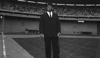 Emmett Ashford, first African American umpire in the American League, in the Washington-Cleveland opener in Washington on April 11, 1966. (AP Photo/Harvey Georges)