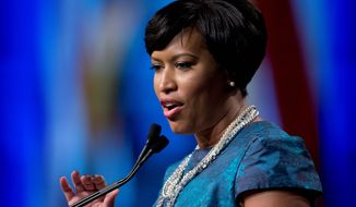 """In a city as prosperous as ours, we can level the playing field and make sure our residents are paid a good wage so fewer families are forced to leave,"" says D.C. Mayor Muriel Bowser, following the lead of other big cities and neighboring counties. (Associated Press)"