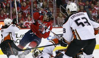 Washington Capitals right wing Tom Wilson (43) falls after his shot misses against Anaheim Ducks goalie Frederik Andersen (31), from Denmark, as defenseman Clayton Stoner (3) defends, in the first period of an NHL hockey game, Sunday, April 10, 2016, in Washington. (AP Photo/Alex Brandon)