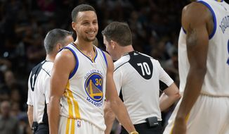 Golden State Warriors guard Stephen Curry (30) smiles during the second half of an NBA basketball game against the San Antonio Spurs, Sunday, April 10, 2016, in San Antonio. Golden State won 92-86. (AP Photo/Darren Abate)