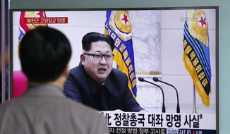 "A man watches a TV news program showing file footage of North Korean leader Kim Jong-un at Seoul Railway Station in Seoul, South Korea, Monday, April 11, 2016. A colonel from North Korea's military spy agency fled to South Korea last year in a rare senior-level defection, Seoul officials said Monday. The letters read ""True, A colonel from North Korean military's General Reconnaissance Bureau Asylum."" (AP Photo/Lee Jin-man)"