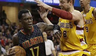Atlanta Hawks' Dennis Schroder (17), from Germany, drives past Cleveland Cavaliers' Matthew Dellavedova (8), from Australia, in the first half of an NBA basketball game Monday, April 11, 2016, in Cleveland. (AP Photo/Tony Dejak)