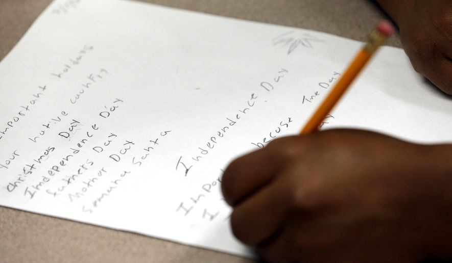 "HOLD FOR RELEASE UNTIL 12:01 A.M. EDT. THIS STORY MAY NOT BE PUBLISHED, BROADCAST OR POSTED ONLINE BEFORE 12:01 A.M. EDT. - FILE - In this July 1, 2014, file photo, a student at Liberty High School in Houston works on a holiday writing assignment. The school serves a large immigrant population, including ""unaccompanied minors."" (AP Photo/David J. Phillip, File)"