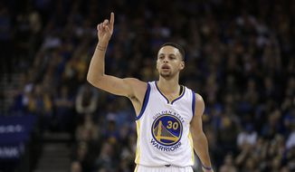 Golden State Warriors' Stephen Curry celebrates a score during the second half of an NBA basketball game against the Portland Trail Blazers Sunday, April 3, 2016, in Oakland, Calif. (AP Photo/Ben Margot)