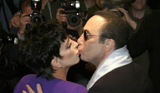 In this Friday May 9, 2003, file photo, entertainer Liza Minnelli kisses her husband David Gest as they arrive at the Dorchester Hotel for Gest's 50th birthday party, London. Music producer David Gest, ex-husband of Liza Minnelli, died Tuesday, April 12, 2016 at 62. (AP Photo/Sang Tan, file)