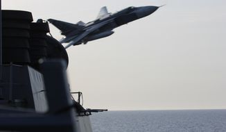 In this image released by the U.S. Navy, a Russian SU-24 jet makes a close-range and low altitude pass near the USS Donald Cook on Tuesday, April 12, 2016, in the Baltic Sea. The Russian attack planes buzzed the U.S. Navy destroyer multiple times on Monday and Tuesday, at one point coming so close, an estimated 30 feet, that they created wakes in the water around the ship, a U.S. official said Wednesday, April 13. (U.S. Navy via AP)