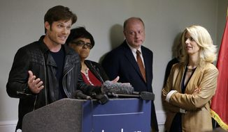 """In this Monday, April 11, 2016 photo, actor Chris Carmack, from the ABC series """"Nashville,"""" left, speaks at a news conference calling on the country music industry to take a stand against proposed laws in Tennessee that LGBT activists see as discriminatory, as Sarah Kate Ellis, left, president and CEO of GLAAD, looks on, in Nashville, Tenn. While a few artists and songwriters have spoken out, many music businesses in Nashville have remained quiet on the issue thus far. (AP Photo/Mark Humphrey)"""