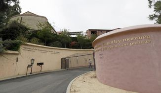 FILE - This June 29, 2015 file photo shows the Sisters of the Immaculate Heart of Mary property in the Los Feliz area of Los Angeles. A Los Angeles judge ruled on Wednesday, April 13, 2016, that a businesswoman's purchase of a former Catholic convent is invalid, clearing the way for Katy Perry to purchase the hilltop property. (AP Photo/Nick Ut, File)