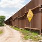The fence marking the border between Mexico and the United States is photographed on Wednesday, July 16, 2014, in El Calaboz, Texas. (AP Photo/Valley Morning Star, David Pike) ** FILE **