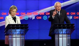"""When this campaign began, I said that we've got to end the starvation minimum wage of $7 and a quarter, raise it to $15,"" Sen. Bernard Sanders said at a Democratic presidential debate in Brooklyn. ""Secretary Clinton said, 'Raise it to $12.' There's a difference. What has happened is history has outpaced Secretary Clinton because all over this country people are standing up and saying $12 is not good enough."" (Associated Press)"