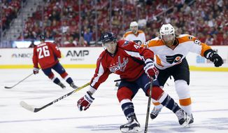 Washington Capitals right wing Tom Wilson (43) skates with the puck with Philadelphia Flyers left wing Jakub Voracek (93), from the Czech Republic, behind him during the first period of Game 1 of a first-round NHL hockey Stanley Cup playoff series Thursday, April 14, 2016, in Washington. (AP Photo/Alex Brandon) **FILE**
