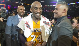 Los Angeles Lakers' forward Kobe Bryant reacts with former teammates Brian Shaw, left,  and Rick Fox after an NBA basketball game against the Utah Jazz at Staples Center in Los Angeles, on Wednesday, April 13, 2016. Kobe Bryant went out with a Hollywood ending to his remarkable career. He scored 60 points in his final NBA game Wednesday night, wrapping up 20 years in the NBA with an unbelievable offensive showcase in the Lakers' 101-96 victory over the Utah Jazz. (Michael Goulding/The Orange County Register via AP)   MAGS OUT; LOS ANGELES TIMES OUT; MANDATORY CREDIT