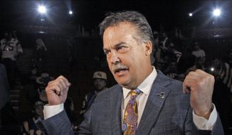 St. Louis Rams coach Jeff Fisher takes questions at a news conference at the Forum in Inglewood, Calif., on Friday, Jan. 15, 2016. The Rams are returning to play in 2016 in the Los Angeles area. A new stadium is to be built at a site near the Forum. (AP Photo/Nick Ut)