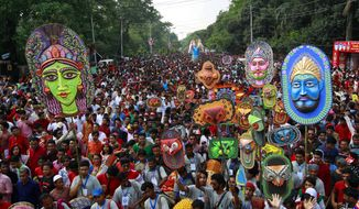 People take out a colorful procession to celebrate Bengali New Year, in Dhaka, Bangladesh, Thursday, April 14, 2016. The Bengali New Year follows a calendar which is a union of the lunar and solar one and was introduced nearly 560 years back by Mughal Emperor Akbar for facilitation of tax collection as it agreed with the harvest season. (AP Photo/A.M. Ahad)