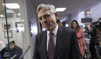 Judge Merrick Garland, President Barack Obama's choice to replace the late Justice Antonin Scalia on the Supreme Court, arrives for a meeting with Sen. Elizabeth Warren, D-Mass., on Capitol Hill in Washington, Thursday, April 14, 2016.  (AP Photo/J. Scott Applewhite)