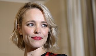 Actress Rachel McAdams poses for photographers after a press conference in Tokyo, Thursday, April 14, 2016. (AP Photo/Shizuo Kambayashi)