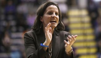 Hartford head coach Jennifer Rizzotti reacts during the second half of her team's 61-52 loss to Albany in their NCAA college basketball game in the championship of the America East Conference tournament on, Saturday, March 16, 2013, in Albany, N.Y. (AP Photo/Mike Groll)