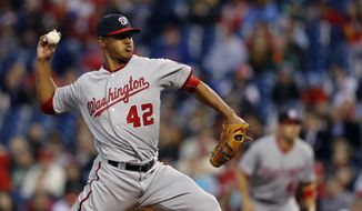 Washington Nationals' Joe Ross pitches during the first inning of a baseball game against the Philadelphia Phillies, Friday, April 15, 2016, in Philadelphia. (AP Photo/Matt Slocum)