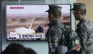 "South Korean army soldiers pass by a TV news program showing a file footage of a missile launch conducted by North Korea at Seoul Railway Station in Seoul, South Korea, Friday, April 15, 2016. A North Korean launch of a missile on the birthday of its revered founder appears to have failed, South Korean and U.S. defense officials said Friday. The letters at a screen read: ""North Korea launched a missile from its east coast."" (AP Photo/Ahnn Young-joon)"