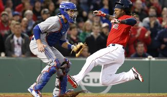 Boston Red Sox's Hanley Ramirez slides into home on a double by Travis Shaw ahead of the throw to Toronto Blue Jays catcher Josh Thole during the first inning of a baseball game at Fenway Park, Friday, April 15, 2016, in Boston. (AP Photo/Mary Schwalm)