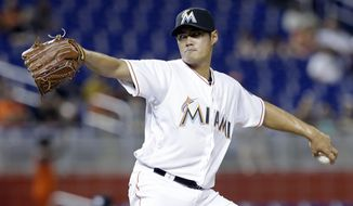 Miami Marlins starting pitcher Wei-Yin Chen pitches against the Atlanta Braves during the first inning of a baseball game Friday, April 15, 2016, in Miami. (AP Photo/Alan Diaz)