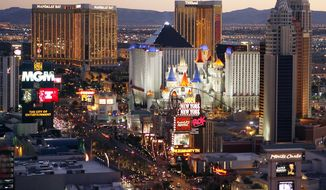 In this Oct. 20, 2009 photo, casinos are pictured on the Las Vegas Strip. A new report by the Las Vegas tourism board shows visitors are spending more money on their trips to Sin City. The latest statistics come from the Las Vegas Convention and Visitors Authority, which issued its visitor profile study results this month.(AP Photo/Isaac Brekken, File)