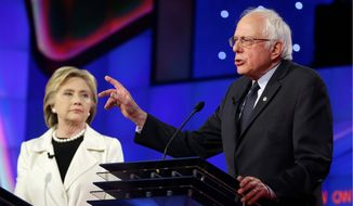 The resourceful Sen. Bernard Sanders is fundraising off the big money style of rival Hillary Clinton. They two are seen here at a recent CNN presidential debate in Brooklyn. (AP Photo/Seth Wenig)