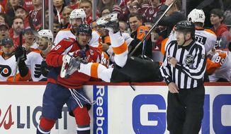 Washington Capitals left wing Alex Ovechkin (8), from Russia, checks Philadelphia Flyers center Brayden Schenn (10) upside down into the bench during the first period of Game 2 in the first round of the NHL Stanley Cup hockey playoffs, Saturday, April 16, 2016, in Washington. (AP Photo/Alex Brandon)
