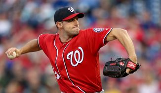 Washington Nationals starting pitcher Max Scherzer throws in the first inning of a baseball game against the Philadelphia Phillies, Saturday, April 16, 2016, in Philadelphia. (AP Photo/Laurence Kesterson)