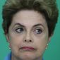Brazil's President Dilma Rousseff reacts during a press conference where she spoke about her impeachment process, at Planalto Presidential Palace, in Brasilia, Monday, April 18, 2016. (AP Photo/Eraldo Peres)