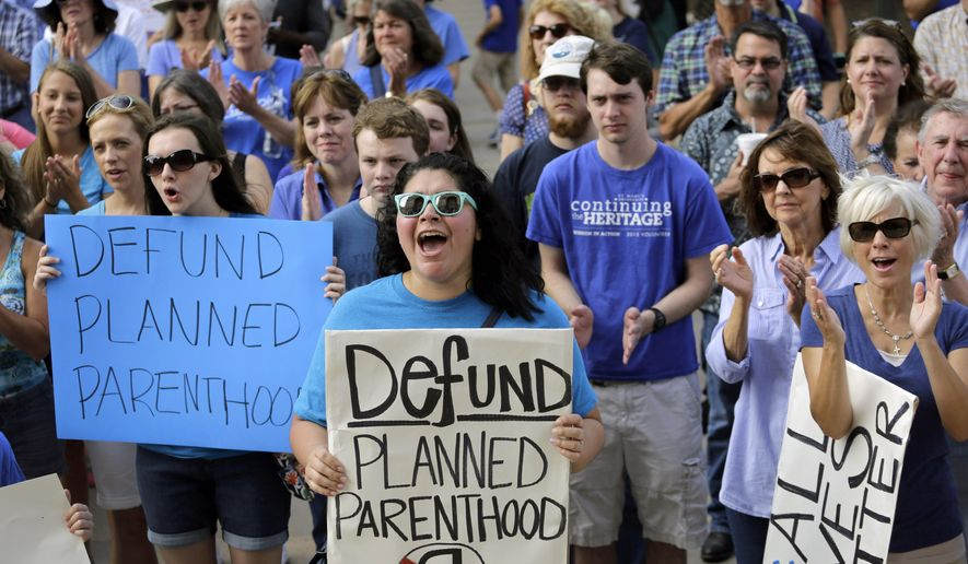 Anti-abortion activists rally in Austin, Texas, to condemn the use in medical research of tissue samples obtained from aborted fetuses. (Associated Press) ** FILE **