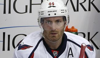 Washington Capitals defenseman Brooks Orpik (44) sits on the bench during an NHL hockey game against the Pittsburgh Penguins in Pittsburgh, Sunday, March 20, 2016. (AP Photo/Gene J. Puskar)