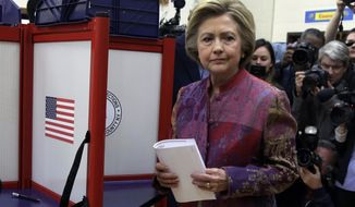 Democratic presidential candidate Hillary Clinton prepare to scan her ballot at the Grafflin Elementary School in Chappaqua, N.Y., Tuesday, April 19, 2016. (AP Photo/Richard Drew)