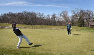 ADVANCE FOR WEEKEND EDITIONS - In this March 30, 2016 photo, Bud Stanley of Sarver, Pa., puts some body language into his putt on the 4th hole at Birdsfoot Golf Course in South Buffalo, near Freeport, Pa. (Steve Mellon/Pittsburgh Post-Gazette via AP) MANDATORY CREDIT