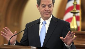 Kansas Gov. Sam Brownback speaks to the legislature in Topeka on Jan. 12, 2016. (Associated Press) **FILE**