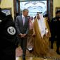 fine line: President Obama was visiting Saudi King Salman in Riyadh on Wednesday as politicians back home were calling for the administration to release information implicating a number of Saudis in the Sept. 11, 2001, terrorist attacks. (Associated Press)