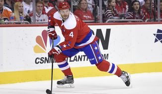 Washington Capitals defenseman Taylor Chorney (4) skates with the puck during the second period of an NHL hockey game against the Philadelphia Flyers, Sunday, Feb. 7, 2016, in Washington. (AP Photo/Nick Wass)
