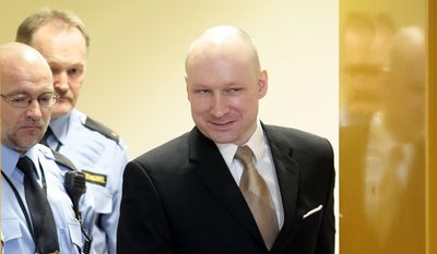 In this Tuesday, March 15, 2016, file photo of Anders Behring Breivik enters a courtroom in Skien, Norway. A court ruled on Wednesday April 20, 2016 that Breivik's human rights have been violated during his imprisonment for terrorism and mass murder. (Lise Aserud, NTB scanpix via AP, File)