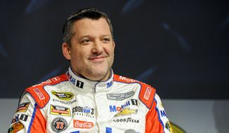 Stewart Haas Racing co-owner and driver Tony Stewart talks to members of the media during the NASCAR Charlotte Motor Speedway Media Tour in Charlotte, N.C., Thursday, Jan. 21, 2016. (AP Photo/Mike McCarn)