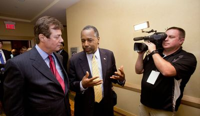 Donald Trump strategist Paul J. Manafort, left, chats with former presidential candidate Ben Carson as they head to a Trump for president reception at the Republican National Committee Spring Meeting, Thursday, April 21, 2016, in Hollywood, Fla. (AP Photo/Wilfredo Lee) ** FILE **