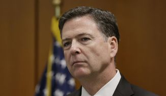 In this April 5, 2016 file photo, FBI Director James Comey speaks in Detroit. (AP Photo/Carlos Osorio, File)