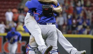 Chicago Cubs starting pitcher Jake Arrieta, left, celebrates with catcher David Ross after the final out of his no-hitter in a baseball game against the Cincinnati Reds, Thursday, April 21, 2016, in Cincinnati. The Cubs won 16-0. (AP Photo/John Minchillo)