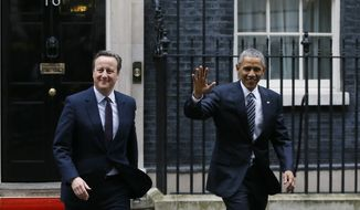 U.S. President Barack Obama, right, and Britain's Prime Minister David Cameron walk from 10 Downing Street, London after a meeting Friday, April, 22, 2016. (AP Photo/Kirsty Wigglesworth)