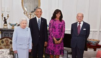 President Barack Obama, center left, and his wife first lady Michelle Obama, center right, pose with Britain's Queen Elizabeth II, left, and Prince Phillip in the Oak room at Windsor Castle ahead of a private lunch hosted by the Queen, Friday, April 22, 2016 (John Stillwell/Pool)