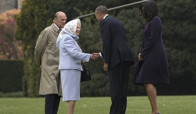 President Barack Obama and first lady Michelle Obama are greeted by Queen Elizabeth II and Prince Philip as they arrive on Marine One at Windsor Castle in Windsor, England, Friday, April 22, 2016. Obama is spending his first full day in the United Kingdom on Friday after arriving Thursday evening. He started by having lunch at Windsor Castle with Queen Elizabeth II, who celebrates her 90th birthday this week.  (AP Photo/Carolyn Kaster)