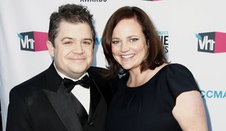 In this Jan. 12, 2012 file photo, Patton Oswalt, left, and his wife Michelle Eileen McNamara arrive at the 17th Annual Critics' Choice Movie Awards in Los Angeles.  (AP Photo/Matt Sayles, File)