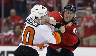 Philadelphia Flyers center Brayden Schenn (10) and Washington Capitals right wing T.J. Oshie (77) fight during the first period of Game 5 in the first round of the NHL Stanley Cup hockey playoffs Friday, April 22, 2016, in Washington. (AP Photo/Alex Brandon)